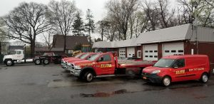 Fleet of tow trucks and service vans.