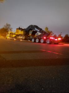 Towing John Deere machinery.